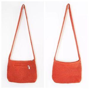 The Sak orange zippered crochet crossbody bag